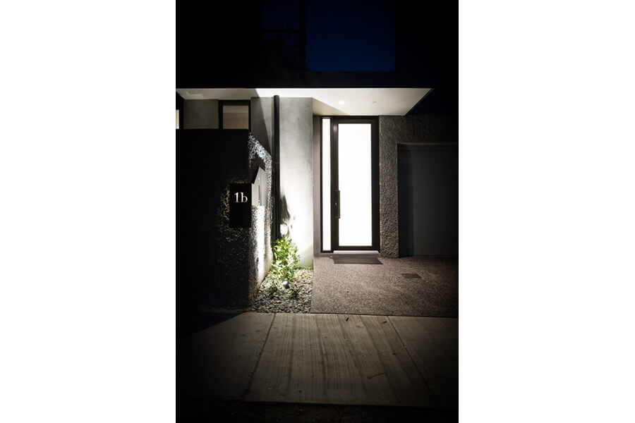 Two-Townhouses---Illuminated-front-entryway-featuring-Aluminium-entry-door