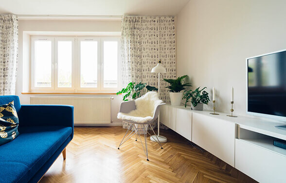 Adding windows at the end of a room, particularly in lighter coloured fittings, gives the illusion that the room continues further than it does.